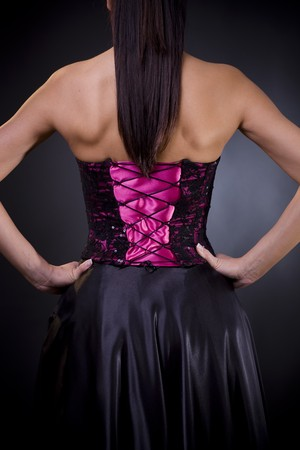 Back side of a birght purple, laced coktail dress with black skirt. photo
