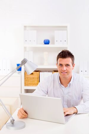 Business man working on laptop computer at home. Stock Photo - 4209103