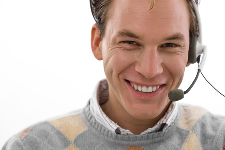 Smiling male customer service operator in headset, white background. Stock Photo - 4209116