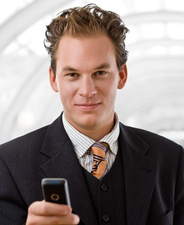 Happy businessman calling on mobile phone, smiling. photo