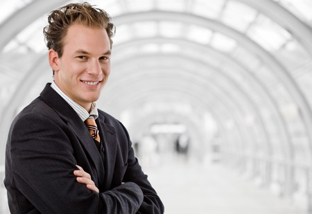 Portrait of happy businessman smiling at office lounge. photo