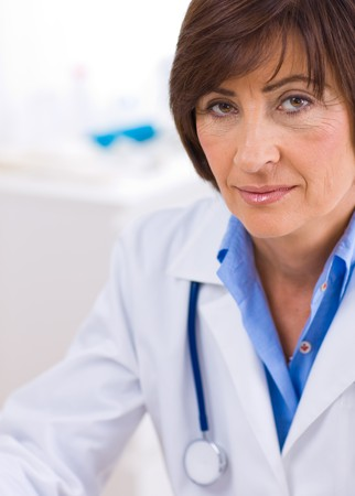 Portrait of senior female doctor working at office. Stock Photo - 4209112