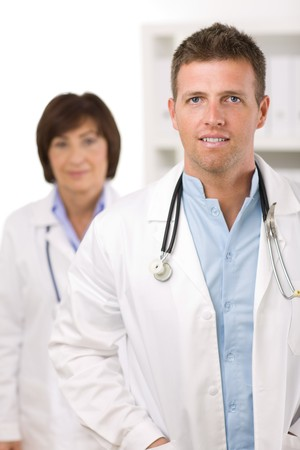 Portrait of medical doctors male and female at office, smiling. photo