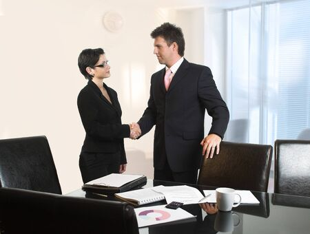 successfull: Young business people are shaking hands after a business deal. Stock Photo