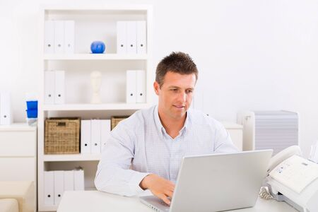 Business man working on laptop computer at home. Stock Photo - 4241366