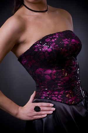Photo of a purple, laced coktail dress with black skirt photo