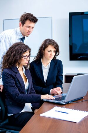 Young businesspeople working together in business team on laptop computer in meeting room at office. Stock Photo - 4244951