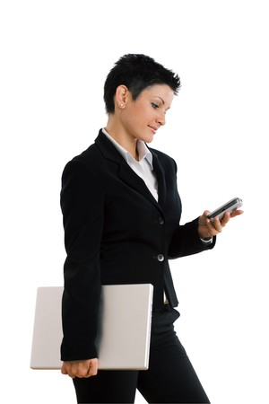 Happy businesswoman with mobile phone and laptop computer, smiling, isolated on white. photo