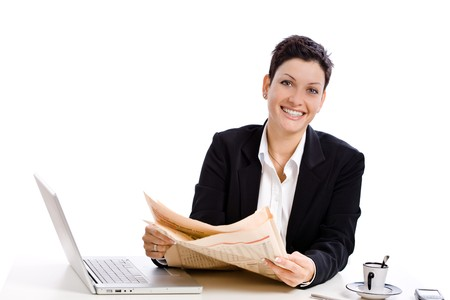Businesswoman reading financial newspaper, white background. photo