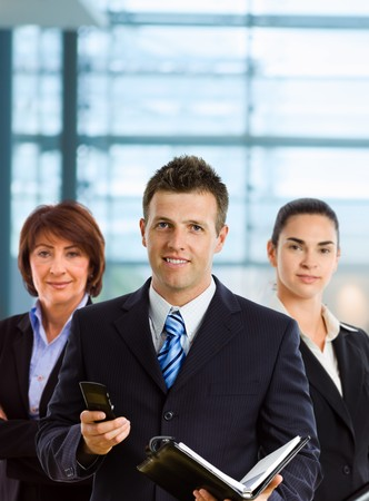 Happy businesspeople team up for a group portrait.  photo