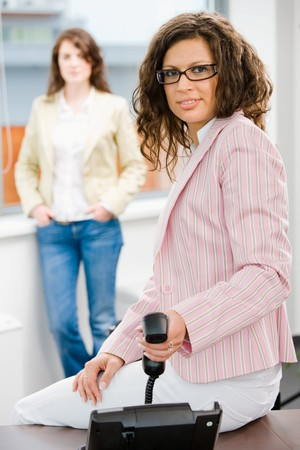 Businesswomen at office, business woman calling on phone. Stock Photo - 4366499
