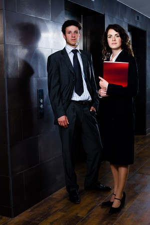 Corporate businesspeople businessman and businesswoman standing side by side posing for team portrait at office corridor. photo