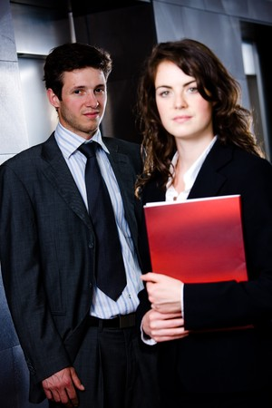 Corporate businesspeople businessman and businesswoman standing side by side posing for team portrait at office corridor. Stock Photo - 4366500
