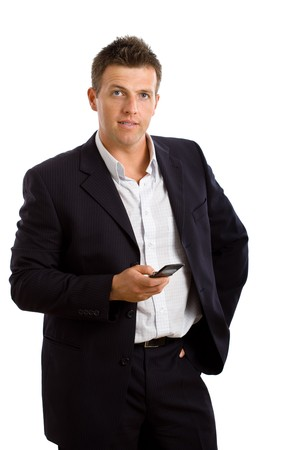 Studio portrait of businessman using mobile phone. Isolated on white background. photo
