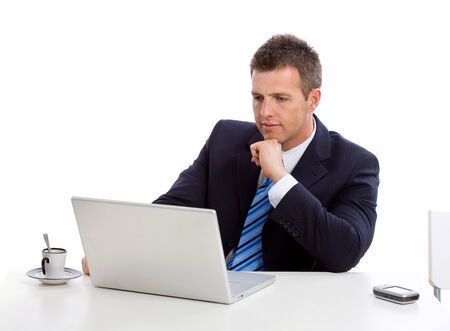 open collar: Businessman thinking over his laptop computer, looking seriously at screen. Stock Photo