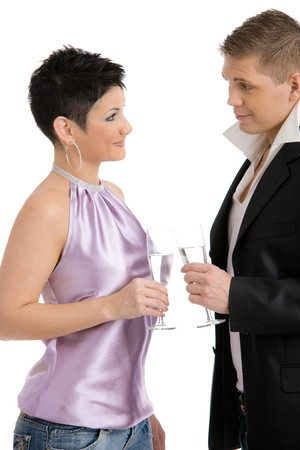 Trendy young couple clinking with champagne, looking each other, flirting. Isolated on white background. photo