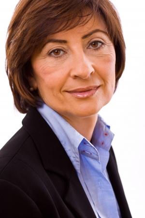 Portrait of senior businesswoman isolated on white background. Imagens