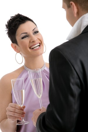 Happy young woman clinking with champagne, smiling. Isolated on white background, selective focus on woman. photo