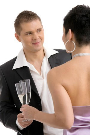 Trendy young couple clinking with champagne. Isolated on white background, selective focus on man. photo