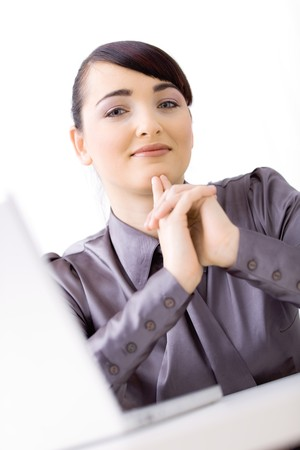 Young attractive businesswoman sitting at desk at office, thinking. Stock Photo - 4386952