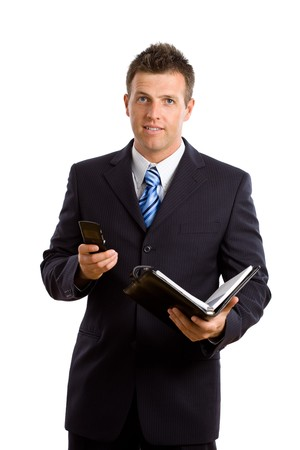 Studio portrait of businessman using mobile phone, holding a personal organizer. Isolated on white background. photo