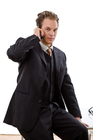Businessman calling on mobile phone, white background. photo