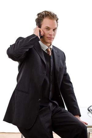 Businessman calling on mobile phone, white background. photo