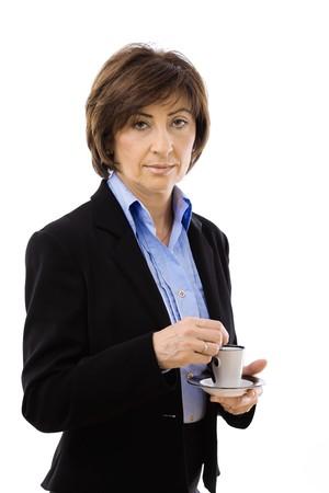 Senior businesswoman drinking coffe, isolated on white background. photo
