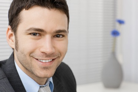 Portrait of happy smiling young businessman at office. Stock Photo - 4403188