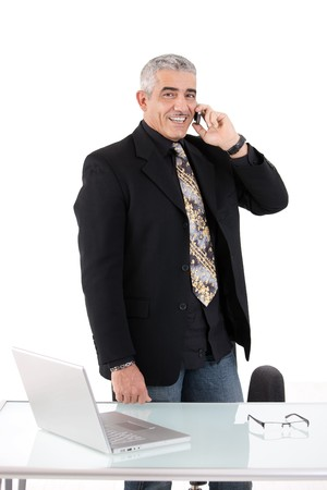 Gray haired mature businessman calling on mobile phone, smiling, isolated on white background. Stock Photo - 4403171