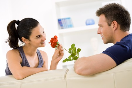 Romantic man giving red rose to woman for Valentine's Day. Stock Photo - 4535047