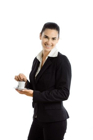 Happy young businesswoman stirring coffee, looking at camera, smiling. Isolated on white background. photo