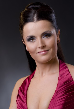 Closeup protrait of an attractive young women in evening dress and makeup. photo