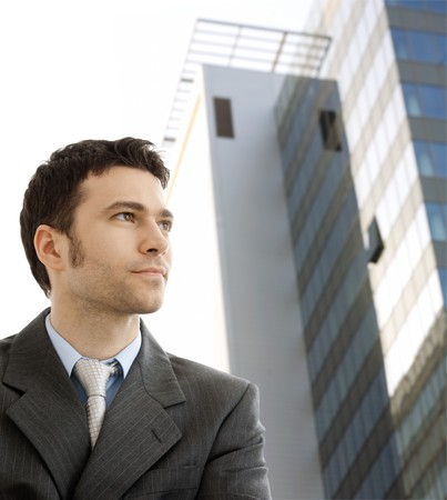 officetower: Portrait of successful young businessman at corporate location. Stock Photo