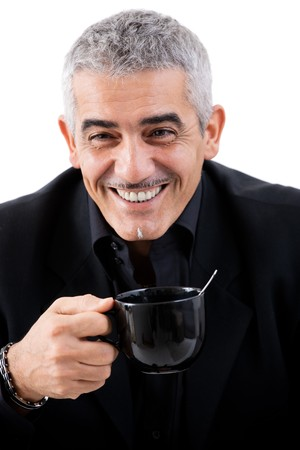gratified: Happy mature businessman drinking tea, smiling, isolated on white background. Stock Photo