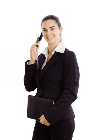 Young businesswoman wearing black suit,  holding personal organizer, talking on mobile phone. Isolated on white background. photo