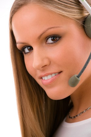 Happy young customer representative girl calling on headset, smiling, isolated on white background. Stock Photo - 4560078