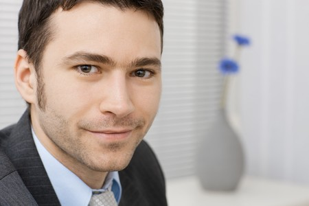 Portrait of happy smiling young businessman at office. Stock Photo - 4560063