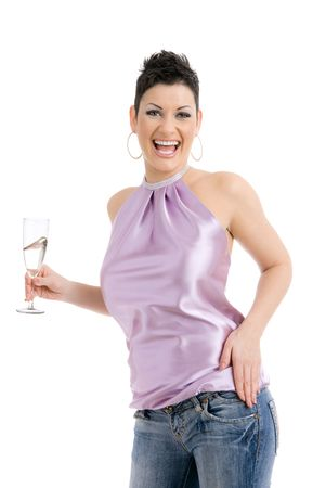 Happy young woman dressed for party holding a glass of champagne, laughing. Isolated on white background. photo