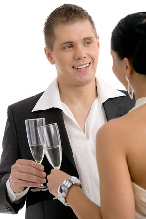 Happy young man clinking with champagne, smiling. Isolated on white background, selective focus on man. Stock Photo - 4580081