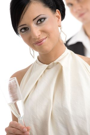 european expression face: Closeup portrait of beautiful young woman wearing white top holding a glass of champagne, smiling. Isolated on white background. Stock Photo