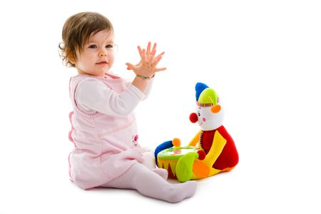 Happy baby girl sitting on floor playing with toy smiling, isolated on white background. Stock Photo - 4583301