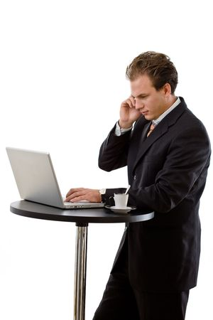 Businessman working on laptop and calling on phone, white background. photo