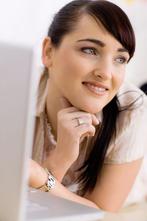 Closeup portrait of happy young women resting at home and browsing internet on laptop computer, smiling. photo