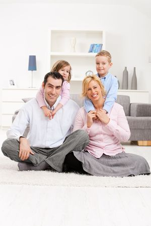 Happy family portrait, children hugging their parents. Stock Photo - 5024756
