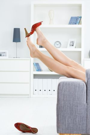legs stockings: Woman legs in stockings, taking off high heel shoes. Stock Photo