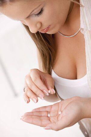 Closeup of beautiful girl taking pills. Stock Photo - 5071075