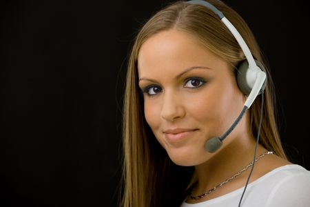 Young happy beautiful customer service operator girl in headset, smiling, isolated on black background. Stock Photo - 5102006