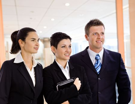 Young business team standing in corporate office lobby. Stock Photo - 5101103