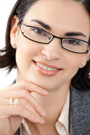 fulfilled: Portrait of happy young attractive businesswoman thinking, smiling. White background.